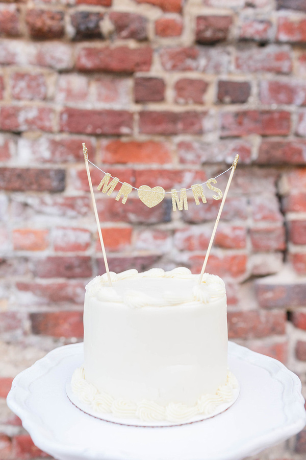 gold cake topper - photo by VA Photography http://ruffledblog.com/handcrafted-real-vow-renewal