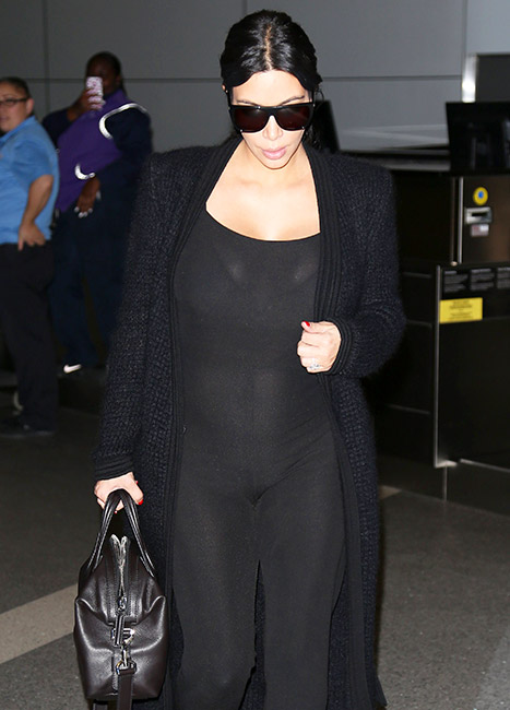 Kim Kardashian arrives at LAX on Wednesday, July 22.