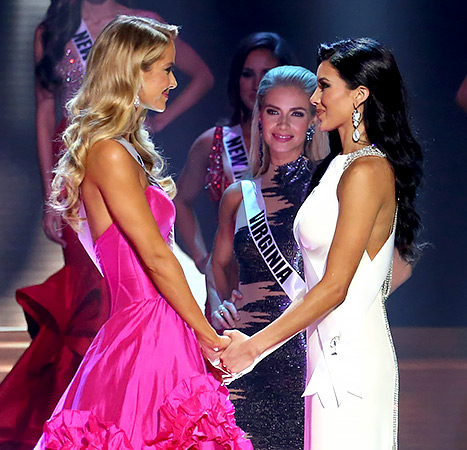 Miss Oklahoma Olivia Jordan and Miss Texas Ylianna Guerra onstage at the 2015 Miss USA Pageant Only On ReelzChannel at The Baton Rouge River Center on July 12, 2015 in Baton Rouge, Louisiana.