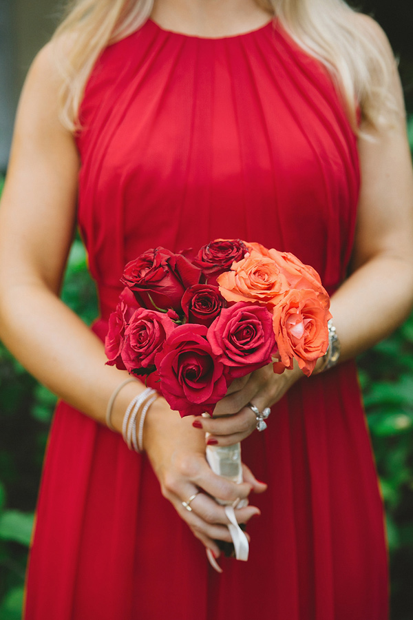 red and orange bouquet - photo by Geoff Duncan http://ruffledblog.com/punta-mita-destination-wedding-and-rehearsal-dinner