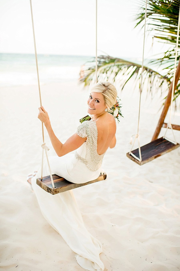 bride on a swing - photo by Cynthia Rose Photography http://ruffledblog.com/relaxed-destination-wedding-in-tulum