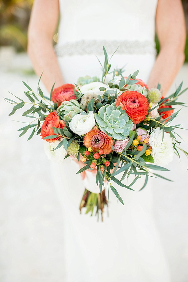 orange bouquet with succulents - photo by Cynthia Rose Photography http://ruffledblog.com/relaxed-destination-wedding-in-tulum