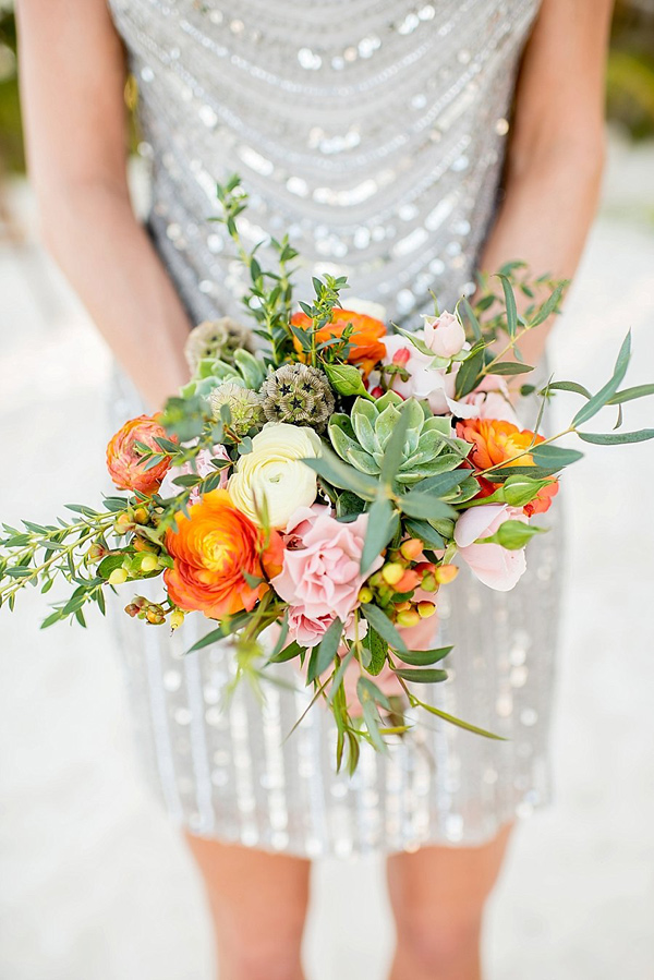 tropical inspired bouquet - photo by Cynthia Rose Photography http://ruffledblog.com/relaxed-destination-wedding-in-tulum