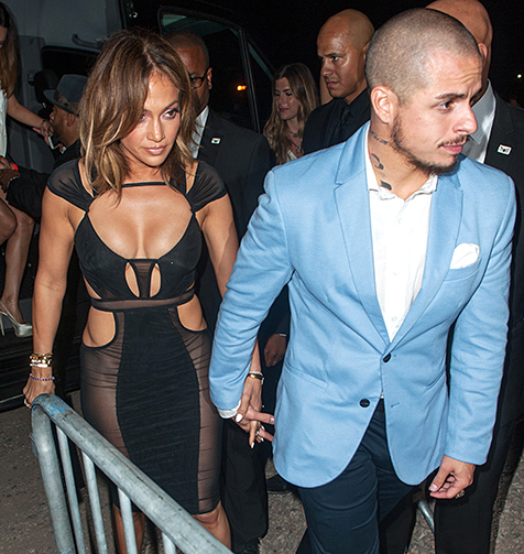 Jennifer Lopez and Casper Smart hold hands on the way to her birthday party at 1OAK in Southampton, N.Y. on July 25.