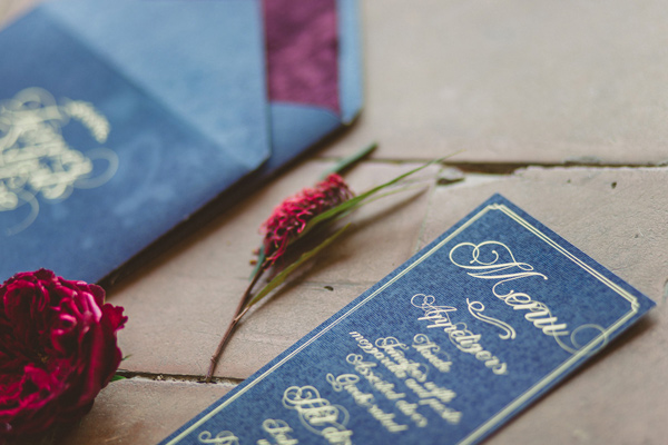 red and blue wedding invitations - photo by Darya Kamalova http://ruffledblog.com/vintage-inspired-italian-alps-wedding
