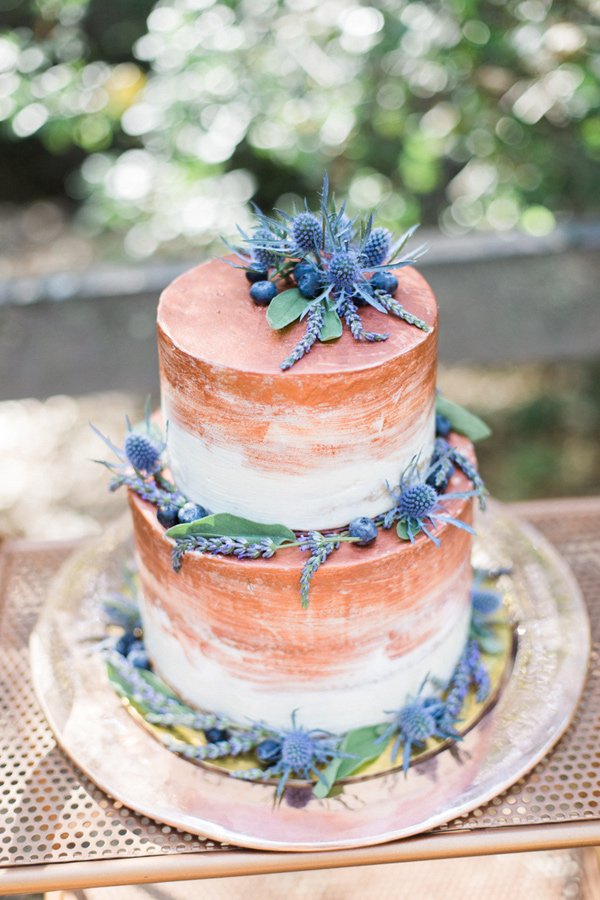 copper painted wedding cake - photo by Olivia Richards Photography http://ruffledblog.com/natural-woodsy-and-copper-wedding-inspiration