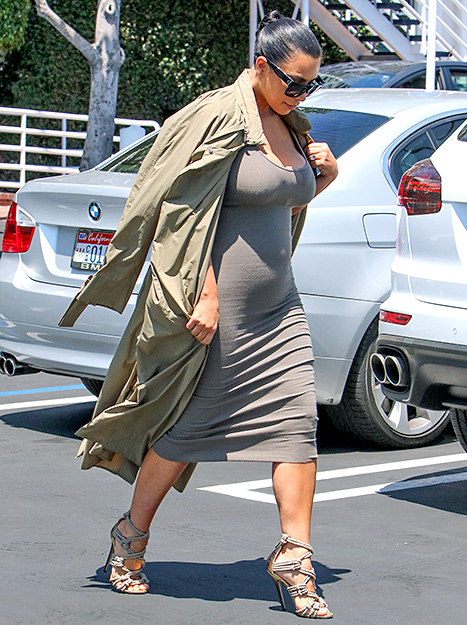 Pregnant Kim Kardashian reveals her blossoming baby bump while out in L.A. on Thursday, July 16.