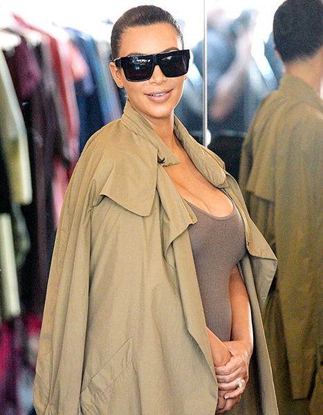 Pregnant Kim Kardashian flashes a smile while shopping on July 16, in Los Angeles.