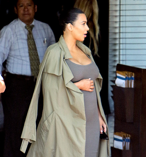 Kardashian, pregnant with her second child, is snapped cradling her baby bump on July 16.