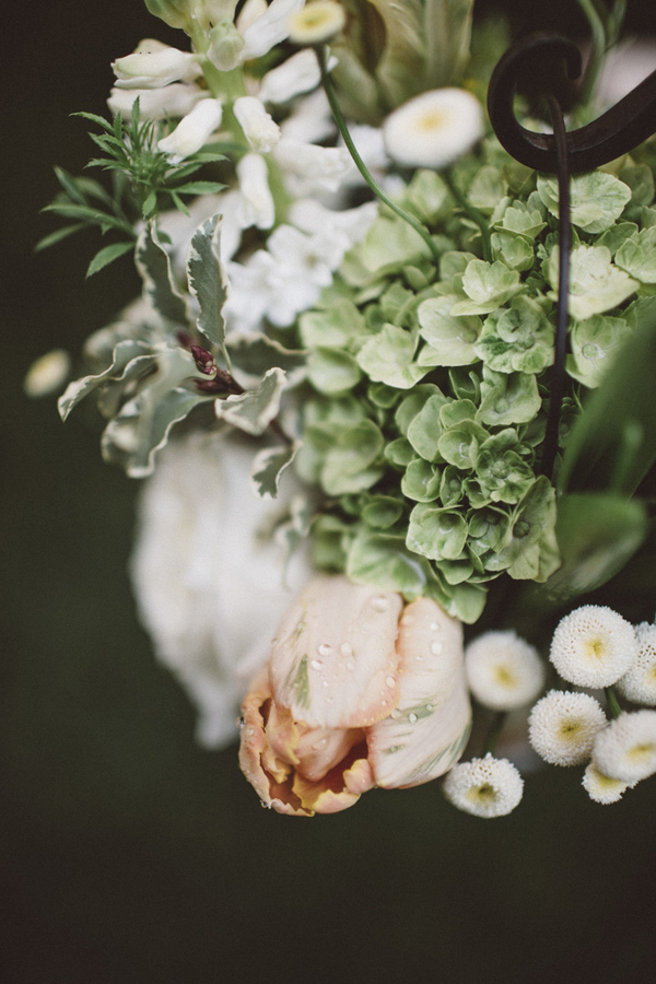 parrot tulip and hydrangea floral arrangement - photo by A Fist Full of Bolts http://ruffledblog.com/vintage-glam-wedding-at-bella-luna-farms