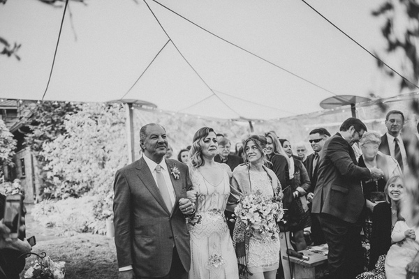 ceremony processional - photo by A Fist Full of Bolts http://ruffledblog.com/vintage-glam-wedding-at-bella-luna-farms