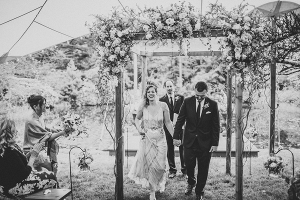 ceremony recessional - photo by A Fist Full of Bolts http://ruffledblog.com/vintage-glam-wedding-at-bella-luna-farms