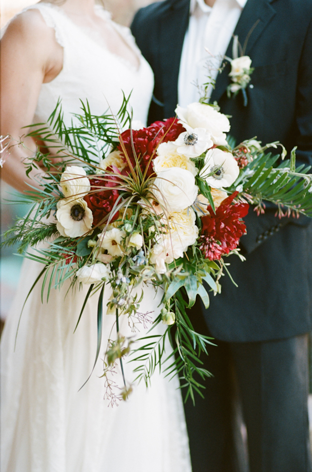 Red and poppy bridal bouquet with air plant | White Rabbit Studios | see more on: http://burnettsboards.com/2015/07/spanish-styled-shoot/
