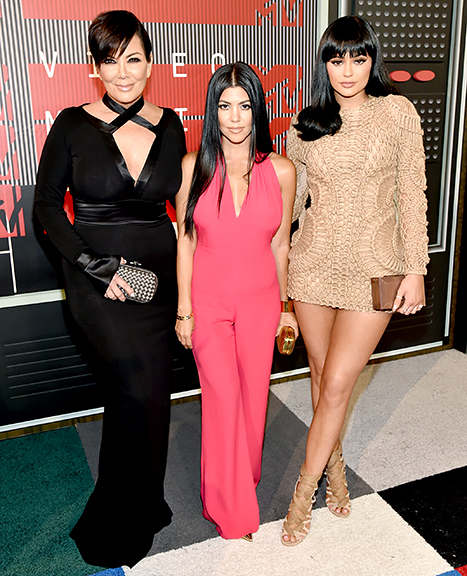 Kris Jenner, Kourtney Kardashian and Kylie Jenner attend the 2015 MTV Video Music Awards.
