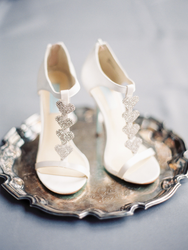 wedding shoes with silver hearts - photo by Taylor Lord http://ruffledblog.com/spring-wedding-with-an-illusion-lace-gown