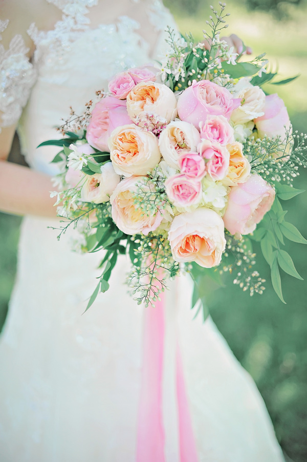 pink and peach bouquet - photo by ArinaB Photography http://ruffledblog.com/soft-and-modern-wedding-inspiration