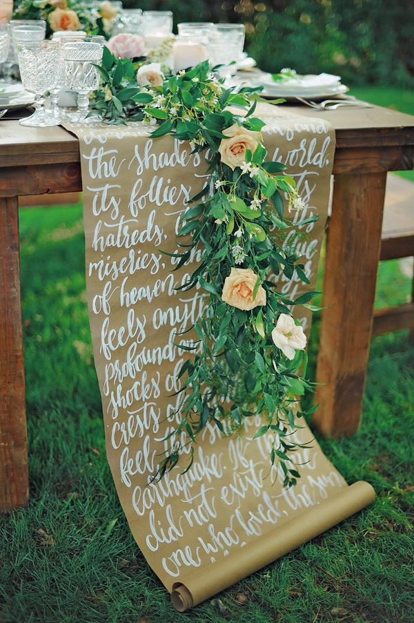 calligraphy scroll table runner - photo by ArinaB Photography http://ruffledblog.com/soft-and-modern-wedding-inspiration