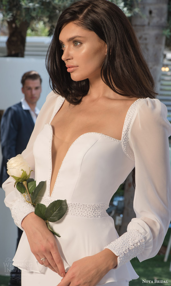 noya bridal riki dalal 2015 style 1110 long sleeve wedding dress deep v illusion neckline close up puff sleeves
