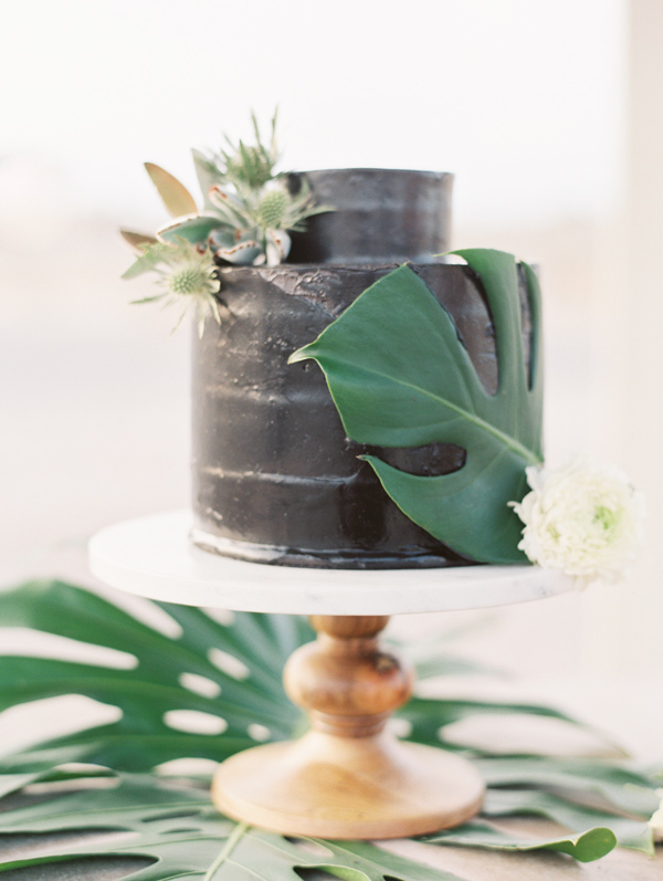 black wedding cake - photo by D'Arcy Benincosa Photography http://ruffledblog.com/minimalist-sand-dunes-wedding-inspiration