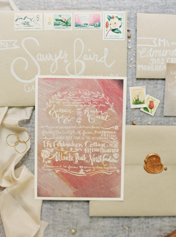 painted wedding invitations - photo by Sawyer Baird http://ruffledblog.com/romantic-north-carolina-beach-wedding