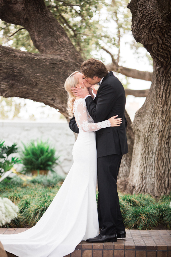 ceremony kiss - photo by Taylor Lord http://ruffledblog.com/spring-wedding-with-an-illusion-lace-gown