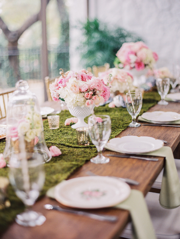 reception table with moss runner - photo by Taylor Lord http://ruffledblog.com/spring-wedding-with-an-illusion-lace-gown