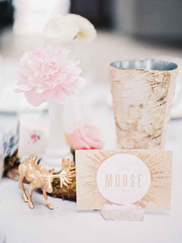 animal themed reception table - photo by Taylor Lord http://ruffledblog.com/spring-wedding-with-an-illusion-lace-gown