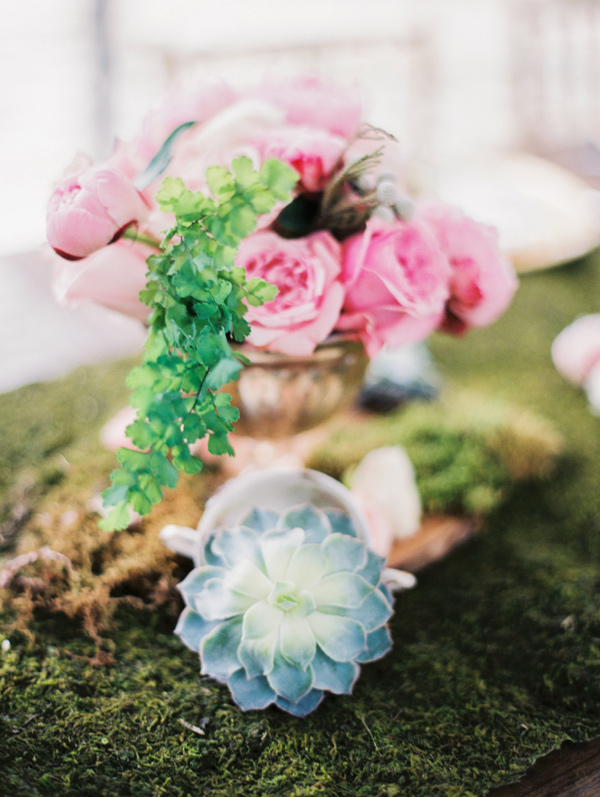 centerpiece with succulents - photo by Taylor Lord http://ruffledblog.com/spring-wedding-with-an-illusion-lace-gown