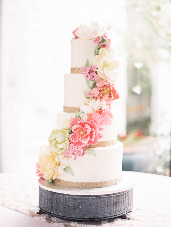 cascading flower cake - photo by Taylor Lord http://ruffledblog.com/spring-wedding-with-an-illusion-lace-gown