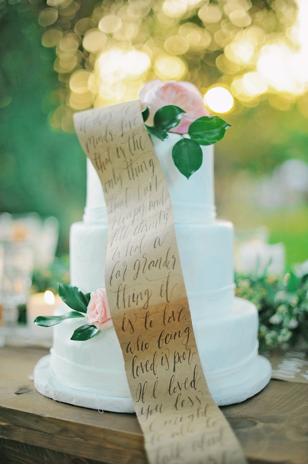 wedding cake with a scroll - photo by ArinaB Photography http://ruffledblog.com/soft-and-modern-wedding-inspiration