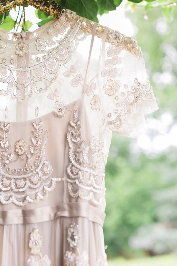 embellished wedding gown - photo by Alexis June Weddings http://ruffledblog.com/london-inspired-jewel-tone-shoot