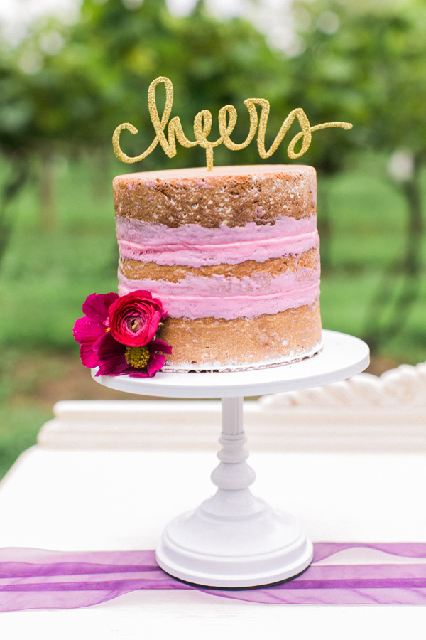 wedding cake with pink icing - photo by Alexis June Weddings http://ruffledblog.com/london-inspired-jewel-tone-shoot