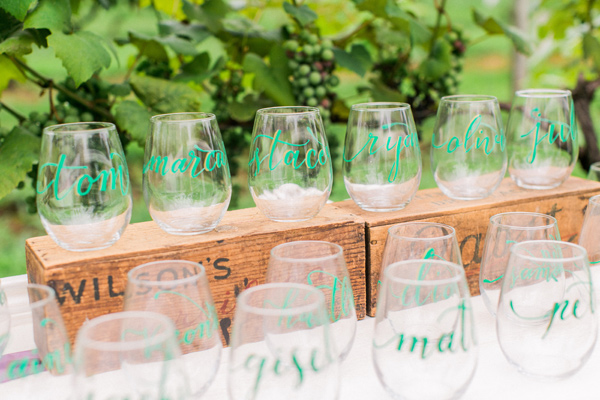 personalized wine glasses - photo by Alexis June Weddings http://ruffledblog.com/london-inspired-jewel-tone-shoot