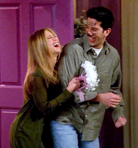 Jennifer Aniston and David Schwimmer laugh it up at their Vegas wedding on Friends. (No white, but a cute little wristlet!)