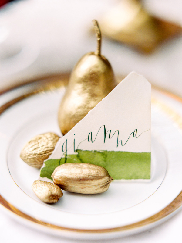 gold pear place setting - photo by Morning Light by Michelle Landreau http://ruffledblog.com/birth-of-venus-wedding-inspiration