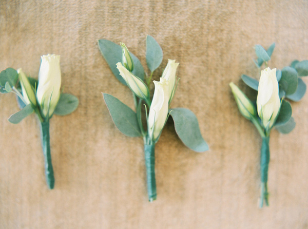 groom boutonnieres - photo by Sawyer Baird http://ruffledblog.com/romantic-north-carolina-beach-wedding