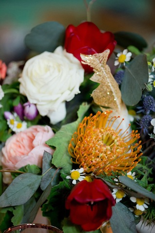 Gold glitter feather and pincushion protea ⎪Amanda Megan Miller Photography ⎪ see more on: http://burnettsboards.com/2015/08/boho-wedding-vintage-chicago-venue/