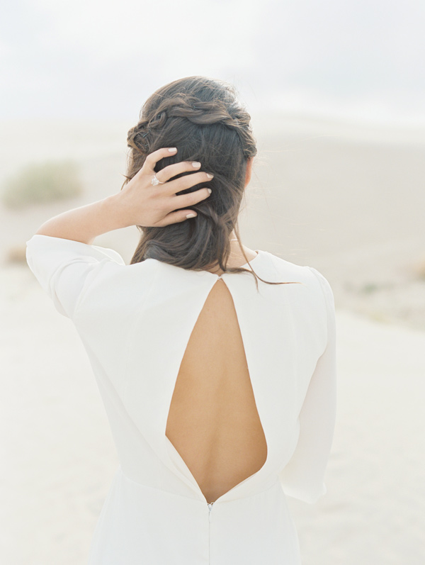 wedding dress back - photo by D'Arcy Benincosa Photography http://ruffledblog.com/minimalist-sand-dunes-wedding-inspiration