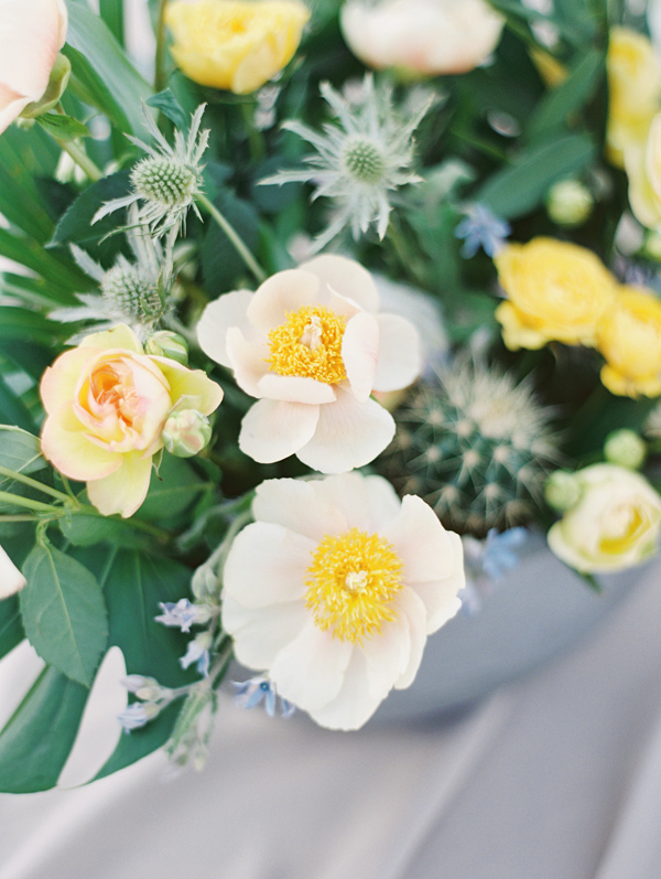 white and yellow centerpiece - photo by D'Arcy Benincosa Photography http://ruffledblog.com/minimalist-sand-dunes-wedding-inspiration