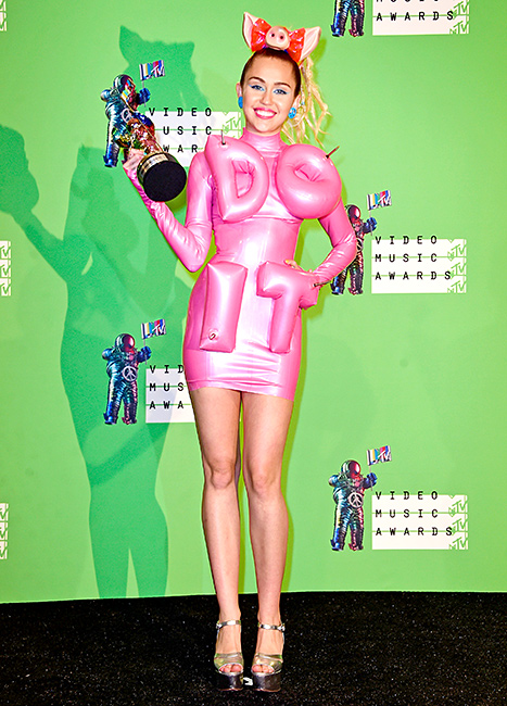 Host Miley Cyrus poses in the press room with an MTV Video Music award at the 2015 MTV Video Music Awards at Microsoft Theater on August 30, 2015 in Los Angeles, California.
