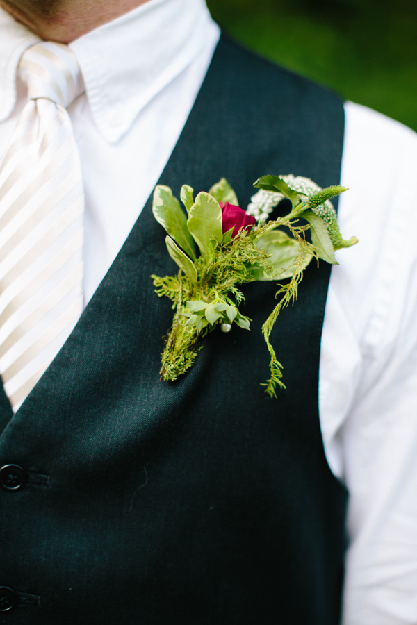 boutonniere with greenery - photo by Chelsea Anderson Photography http://ruffledblog.com/crimson-bohemian-wedding-inspiration