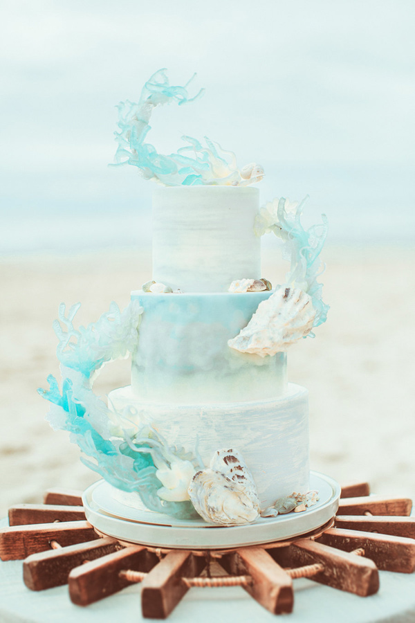 beach wedding cake - photo by Hazelwood Photo http://ruffledblog.com/lincoln-city-beach-wedding-editorial
