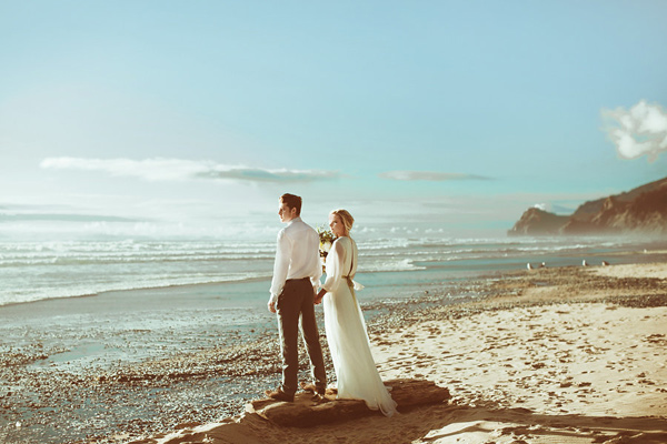 beach wedding - photo by Hazelwood Photo http://ruffledblog.com/lincoln-city-beach-wedding-editorial