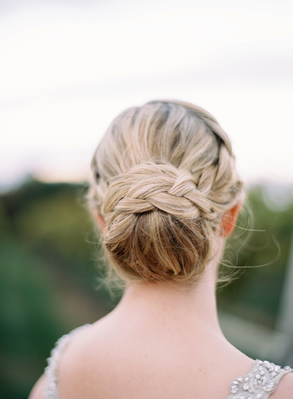 braided bun bridal updo - photo by Elisa Bricker http://ruffledblog.com/southern-keswick-vineyards-wedding