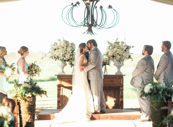 ceremony kiss - photo by Brandi Smyth http://ruffledblog.com/industrial-wedding-in-shreveport
