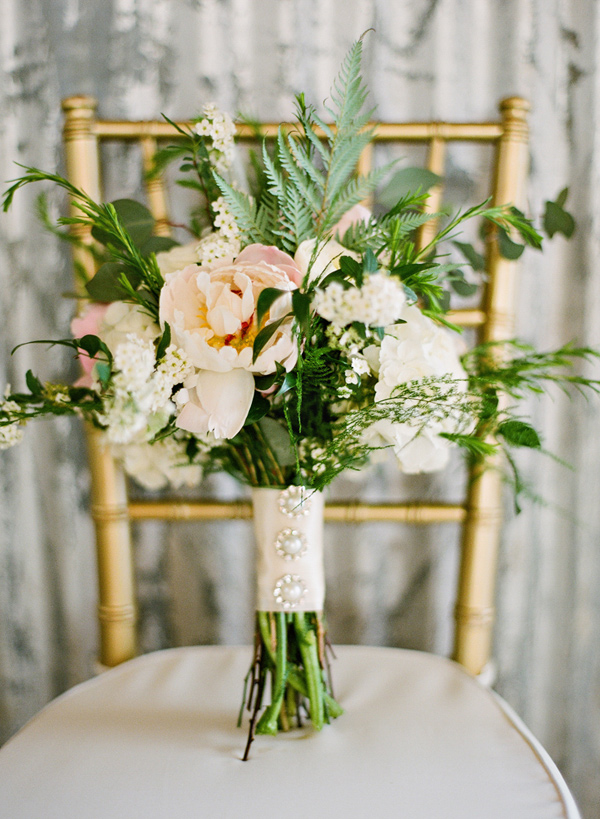 bouquet with leafy greenery - photo by Brandi Smyth http://ruffledblog.com/industrial-wedding-in-shreveport