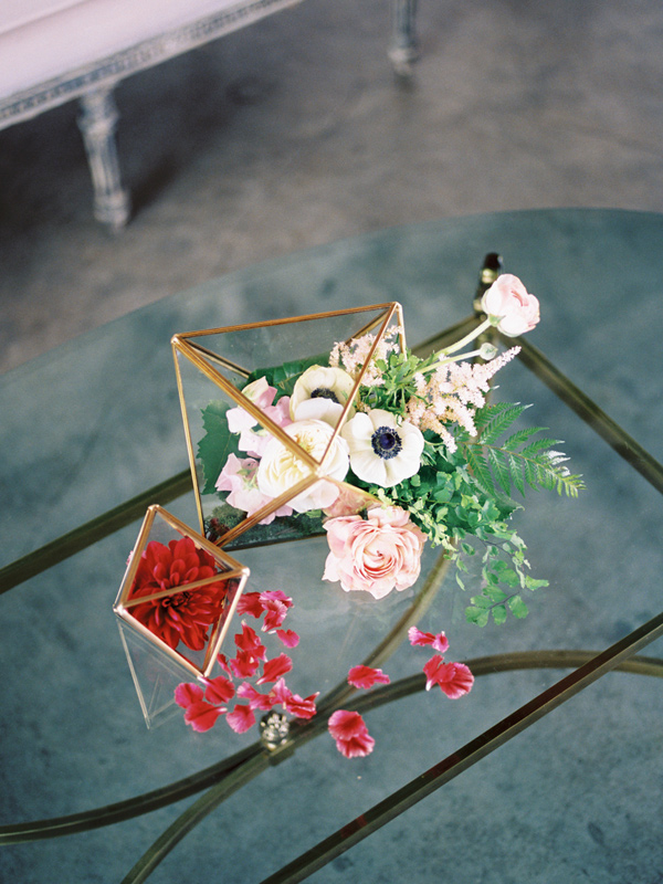 wedding flowers in geometric holders - photo by Ashley Kelemen http://ruffledblog.com/organic-sophistication-in-venice-beach