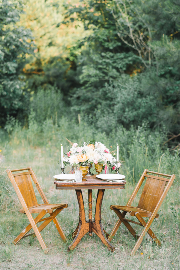 woodland reception table - photo by Sterling Imageworks http://ruffledblog.com/rainy-wedding-day-turned-day-after-session