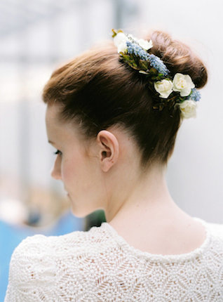 Bun hairstyle with flowers | l'Artisan Photographe | see more on: http://burnettsboards.com/2015/09/urban-alpine-wedding-inspiration-shoot/
