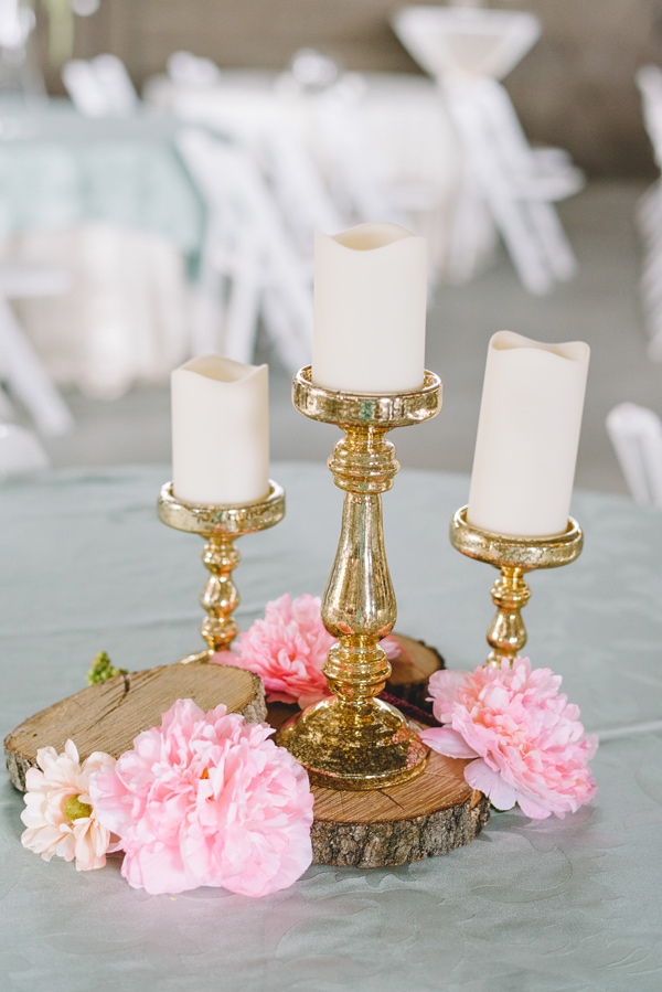 gold candlestick centerpiece - photo by Sterling Imageworks http://ruffledblog.com/rainy-wedding-day-turned-day-after-session